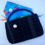sort clutch med flerfarvet foer og dekoration, som matcher foret - aaben