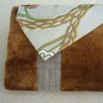 Clutches: ullaulla clutch gylden striber med guldranke syet af møbelstof