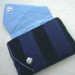Clutches: ullaulla clutch marineblå/sorte striber med blomster og sølvtråd syet af møbelstof